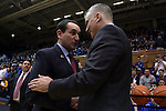 29 December 2014: Duke head coach Mike Krzyzewski (left) and Toledo head coach Tod Kowalczyk (right) shake hands before the game. The Duke University Blue Devils hosted the University of Toledo Rockets at Cameron Indoor Stadium in Durham, North Carolina in a 2014-16 NCAA Men's Basketball Division I game. Duke won the game 86-69.