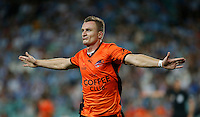 Brisbane Roar Besart Berisha celebrates after scoring during his A-League match against Sydney FC in Sydney, March 14, 2014. Photo by Daniel Munoz/VIEWPRESS EDITORIAL USE ONLY