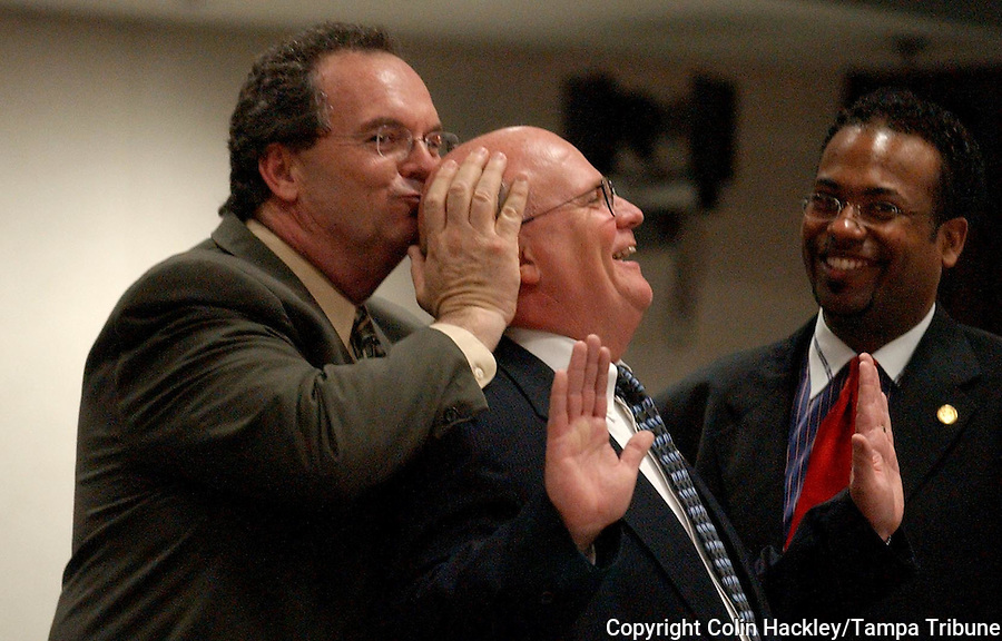 TALLAHASSEE, FL 3/18/03-Rep. Ron Greenstein, D-Coconut Creek, left, playfully smooches the pate of Rep. Dennis Baxley, R-Ocala, after Baxley's subcommittee on Gaming and Parimutuels killed his video lottery bill Tuesday at the Capitol in Tallahassee. Rep. Hank Harper, D-West Palm Beach, is at right. COLIN HACKLEY PHOTO