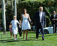 PALM BEACH, FL - JANUARY 06: Melania Trump, Barron Trump and Donald Trump attend the 2013 Trump Invitational Grand Prix at Club Mar-a-Lago on January 6, 2013 in Palm Beach, Florida. Credit: mpi04/MediaPunch
