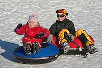 Happy Smiling Young Girl and Mother on Snowtubing Track,  Estonia