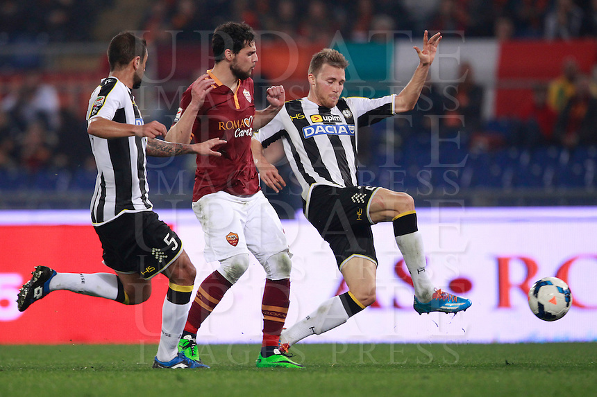 Calcio, Serie A: Roma vs Udinese. Roma, stadio Olimpico, 17 marzo 2014.<br /> AS Roma forward Mattia Destro, center, is challenged by Udinese defenders Danilo Larangeira, of Brazil, left, and Widmer Silvan, of Switzerland, during the Italian Serie A football match between AS Roma and Udinese at Rome's Olympic stadium, 17 March 2014.<br /> UPDATE IMAGES PRESS/Isabella Bonotto