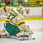 14 December 2013: University of Vermont Catamount Goaltender Brody Hoffman, a Sophomore from Wilkie, Saskatchewan, makes a third period skate save against the Saint Lawrence University Saints at Gutterson Fieldhouse in Burlington, Vermont. The Catamounts defeated their former ECAC rivals, 5-1 to notch their 5th straight win in NCAA non-divisional play. Mandatory Credit: Ed Wolfstein Photo *** RAW (NEF) Image File Available ***