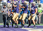 Washington Huskies'  quarterback Cyler Miles celebrates after scoring a touchdown against the Eastern Washington Eagles' at Husky Stadium September 6, 2014 in Seattle. Huskies out lasted the Eagles in a high powered shootout 59-52 in the third highest scoring game in Husky history. ©2014. Jim Bryant  Photo. All Rights Reserved