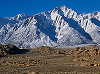 ock formations of Alabama Hills with Lone Pine peak and Sierra Nevada mountains in background, California.