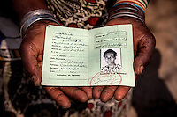 Witchdoctor Maria Mponha (80) shows her identity card from the Mozambican traditional healer's association AMETRAMO, in which she is described as a 'curandeira' or healer in English.