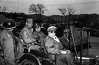Lt. Gen. Matthew Ridgeway; Maj. Gen. Doyle Hickey; and Gen. Douglas MacArthur, Commander in Chief of U.N. Forces in Korea, in a jeep at a command post, Yang Yang, approximately 15 milies north of the 38th parallel, April 3, 1951.  Grigg. (Army)<br /> NARA FILE #:  111-SC-365348<br /> WAR &amp; CONFLICT BOOK #:  1376