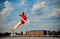 Member of the Baltimore-based modern dance troupe, The Collective, Jessica Fultz, flies across the Inner Harbor. This image is part of a portrait series of the Collective dancers.