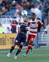 New England Revolution midfielder Lee Nguyen (24) traps the ball as FC Dallas defender Fabian Castillo (11) closes..  In a Major League Soccer (MLS) match, FC Dallas (red) defeated the New England Revolution (blue), 1-0, at Gillette Stadium on March 30, 2013.