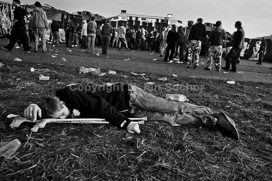 """A young boy sleeps on the ground after dancing the whole night at Czech Free Tekno Festival """"Czarotek"""" close to Kv?tná, Czech Republic, 1 May 2009."""