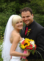 Chelsea and Cyril smile for one of their wedding photo.  Sandy, Utah outdoor wedding ceremony and reception...Photo &copy; http://gsilvaphoto.com.