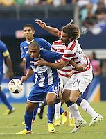 Kyle Beckerman #14 of the USMNT battles Alexander Lopez #16 of Honduras for the ball on July 24, 2013at Dallas Cowboys Stadium in Arlington, TX. USMNT won 3-1.