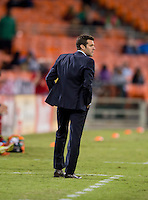 D.C. United head coach Ben Olsen watches his team during the game at RFK Stadium in Washington, DC.  D.C. United defeated Chivas USA, 1-0.