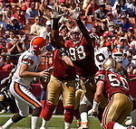 San Francisco 49ers linebacker Julian Peterson (98) rushes Cleveland Browns quarterback Kelly Holcomb (10) on Sunday, September 21, 2003, in San Francisco, California. The Browns defeated the 49ers 13-12.