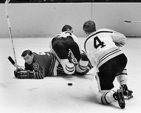 Boston vs. Seals. #4 Bobby Orr stalking Seals Billy Hicke.. #20 Dallas Smith(1968 photo by Ron Riesterer)