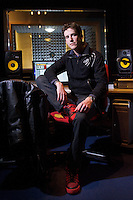 Sound designer and composer Thomas Press, photographed in a sound-recording studio at Toi Whakaari: New Zealand Drama School. Thomas Press graduated from Toi Whakaari with a NZ Diploma of Entertainment Technology in 2005. http://www.thomaspress.co.nz/