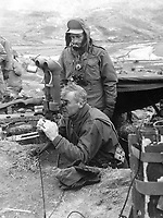 Maj. Gen. Frank Lowe, USA, presidential representative in Korea, examines &quot;flash range&quot; instruments on the Marine front lines.  Explaining the instrument is Marine S.Sgt. Charles Kitching of Redlands, Calif.  March 1951.  T. Sgt. Vance Jobe.  (Marine Corps)<br /> Exact Date Shot Unknown<br /> NARA FILE #:  127-N-A131033<br /> WAR &amp; CONFLICT BOOK #:  1409