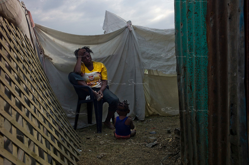 Port Au Prince, Haiti, Jan 25 2010.The 'Pist Aviyasion' IDP camp located between the airport and Cite-Soleil is the new home of more than 10 000 people, very little supplies has reached them so far..