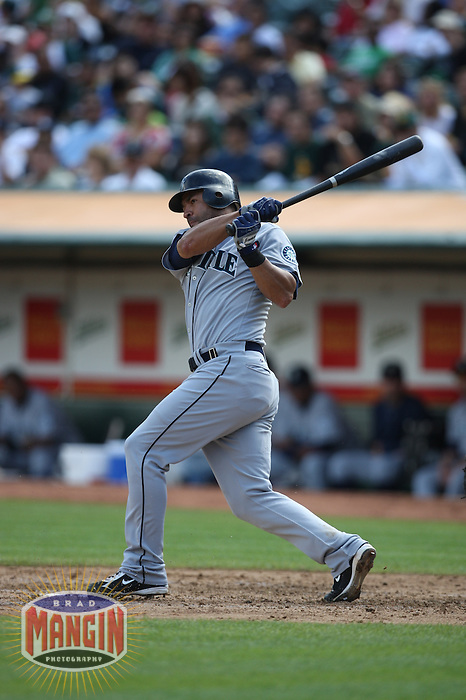 OAKLAND, CA - SEPTEMBER 20:  Miguel Cairo of the Seattle Mariners bats during the game against the Oakland Athletics at the McAfee Coliseum in Oakland, California on September 20, 2008.  The Athletics defeated the Mariners 8-7.  Photo by Brad Mangin