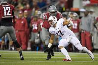 SEATTLE, WA - September 28, 2013: Stanford linebacker A.J. Tarpley rushes the quarterback as Washington State offensive lineman Rico Forbes blocks during play at CenturyLink Field. Stanford won 55-17