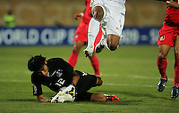 The United States' Tony Taylor (7)  leaps over South Korea's Seung Gyu Kim (12) as he captures a goal attempt during the FIFA Under 20 World Cup Group C match between the United States and South Korea at the Mubarak Stadium on October 02, 2009 in Suez, Egypt. The US team lost 3-0.