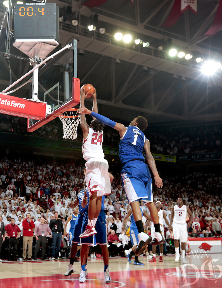 HAWGS ILLUSTRATED JASON IVESTER<br /> Arkansas sophomore Michael Qualls dunks the ball before the final buzzer to beat Kentucky on Jan. 14, 2014, at Bud Walton Arena in Fayetteville.