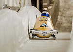 8 January 2016: Francesco Friedrich, piloting his 2-man bobsled for Germany, enters the Chicane straightaway on his first run, ending the day with a combined 2-run time of 1:51.44 and earning an 8th place finish at the BMW IBSF World Cup Championships at the Olympic Sports Track in Lake Placid, New York, USA. Mandatory Credit: Ed Wolfstein Photo *** RAW (NEF) Image File Available ***