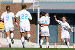 27 November 2009: North Carolina's Casey Nogueira (54) celebrates her first goal with Tobin Heath (behind), Meghan Klingenberg (4), Amber Brooks (22), and Whitney Engen (9). The University of North Carolina Tar Heels defeated the Wake Forest University Demon Deacons 5-2 at Fetzer Field in Chapel Hill, North Carolina in an NCAA Division I Women's Soccer Tournament Quarterfinal game.