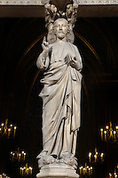 Low angle view of Statue of the Christ blessing the crowds decorating the trumeau of the portal to the upper chapel of La Sainte-Chapelle (The Holy Chapel), 1248, Paris, France. La Sainte-Chapelle was commissioned by King Louis IX of France to house his collection of Passion Relics, including the Crown of Thorns. It is a UNESCO World Heritage Site. Picture by Manuel Cohen.
