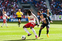 Peguy Luyindula (88) of the New York Red Bulls and Raymon Gaddis (28) of the Philadelphia Union. The New York Red Bulls defeated the Philadelphia Union 2-1 during a Major League Soccer (MLS) match at Red Bull Arena in Harrison, NJ, on March 30, 2013.