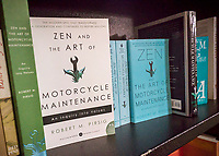 """Copies of """"Zen and the Art of Motorcycle Maintenance: An Inquiry into Values"""" by Robert M. Pirsig is seen in a bookstore in New York on Tuesday, April 25, 2017. Pirsig, the author of the book with a cult following, died in Maine on Monday at the age of 88. (© Richard B. Levine)"""