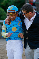 Arkansas Derby winning jockey Mike Smith &amp; Jimmy Barnes sharing a moment together after the race.(Justin Manning/Eclipse Sportswire)