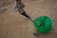 Bedouin kid clean his village. Photo by Oren Nahshon