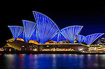 The Sydney Opera House is illuminated in colours during the Vivid Light Festival.