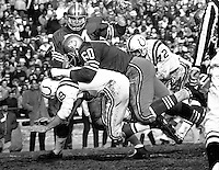 San Francisco 49ers #60 Roland Lakes and #74 Clark Miller sack Baltimore Colts qb Johnny Unitas. (1966 photo by Ron Riesterer)