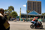 April 21, 2009. Myrtle Beach, SC.. After years of hosting hundreds of thousands of bikers for the annual Bike Week and Black Bike Week rallies, the city council of Myrtle Beach has passed new motorcycle laws to try and put an end to the rallies and promote a more family oriented experience. Many local business owners are outraged at the loss off revenue and the ordinances are to be challenged in court.. Motorcyclists make their way down the Ocean Blvd. strip. New rules require helmets, in contrast to SC state law, and also regulate many other things that make motorcycle riding in the city more difficult.