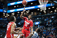 BROOKLYN, NY - Saturday December 19, 2015: JaQuan Lyle (#13) of Ohio State drives to the basket against Alex Poythress (#22) of Kentucky as the two teams square off in the CBS Classic at Barclays Center in Brooklyn, NY.