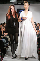 Fashion designer Fotoula Lambros walks runway with model, at the close of her Fotoula Lambrous Design Fall Winter 2012 collection, during BK Fashion Weekend Fall Winter 2012.