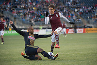 Mar 7, 2015; Philadelphia, PA, USA; Philadelphia Union defender Ethan White (15) puts a slide tackle on Colorado Rapids midfielder Dillon Serna (17) during the second half at PPL Park. The game ended in a 0-0 draw. Mandatory Credit: Derik Hamilton-USA TODAY Sports