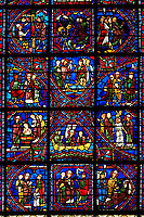 Medieval stained glass Window of the Gothic Cathedral of Chartres, France - dedicated to The life of St Apollinarie. Stained glass panels from bottom left - possible the Healing of the blind son of the judge Thaurus, centre - Apollinaris meeting the Tribune of Ravenna, left - Apollinaris heals the Tribune's wife. Second row from bottom - left - Baptism of the Tribune of Ravenna and his household, centre - Apollinaris going into (or returning from) exile, left - Apollinaris cures the maid possessed by 'an unclean spirit', Third row - left - Apollinaris enters the house of Rufus Patricius, Duke of Ravenna, centre - Through prayer, Apollinaris restores Rufus's daughter to life, right - The Provost orders Apollinaris to sacrifice to the pagan gods. Top row - left - possibly, Apollinaris is visited by an angel In prison , centre - In response to Apollinaris's prayers, a temple of Jupiter collapses, right - The Provost and other witnesses to the destruction of the temple. A UNESCO World Heritage Site..