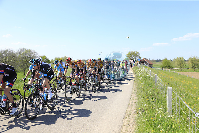 The peloton atop a dike during Stage 2 of the 2016 Giro d'Italia running 190km from Arnhem to Nijmegen, The Nethrerlands. 7th May 2016.<br />