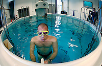 Bjarte Nygaard prepares for a dive by going through his breathing routine. Freediving in a tank belonging to Royal Norwegian Navy Diving School at Haakonsvern Naval base, Norway.