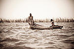 Fishermen ply the waters between Cotonou and Ganvie in Benin.