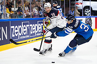 American Skjei (L) and Finland's Markus Hannikainen fight for the puck during the Ice Hockey World Championship quarter-final match between the US and Final in the Lanxess Arena in Cologne, Germany, 18 May 2017. Photo: Marius Becker/dpa /MediaPunch ***FOR USA ONLY***