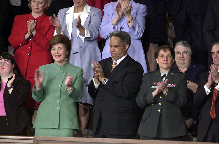 5joint022701 -- Laura Bush give her approval during her husbands address to the Joint Session of Congress.