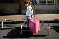 "Haley McKernan, 8, lays a hand on her soap box racing car ""Haley's Comet"" before the start of her first competition on June 8, 2008. Her father and grandfather helped her build the car including the recent paint job with her favorite color, pink."