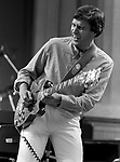 John McLaughlin, Berkeley Jazz Festival, 5/25/84. an English jazz fusion guitarist and composer. He played with Tony Williams's group Lifetime and then with Miles Davis on his landmark electric jazz-fusion albums In A Silent Way, Bitches Brew, and Jack Johnson. His 1970s electric band, the Mahavishnu Orchestra, performed a technically virtuosic and complex style of music that fused eclectic jazz and rock with eastern and Indian influences. His guitar playing includes a range of styles and genres, including jazz, Indian classical music, fusion, and Western classical music.