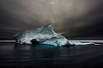 Formerly part of a tabular ice shelf,  an iceberg slumps into the Southern Ocean. Antarctica, 2007<br /> <br /> <br /> Limited edition C-Type Prints available - contact me for more details.