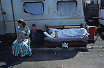 A Croat Roma family outside their caravan. This camp was razed to the ground in 2007 and people forced from the city, as part of Rome's racist scourge to rid themselves of Roma Gypsies. Vicolo Savini Camp, Roma Italy 2001