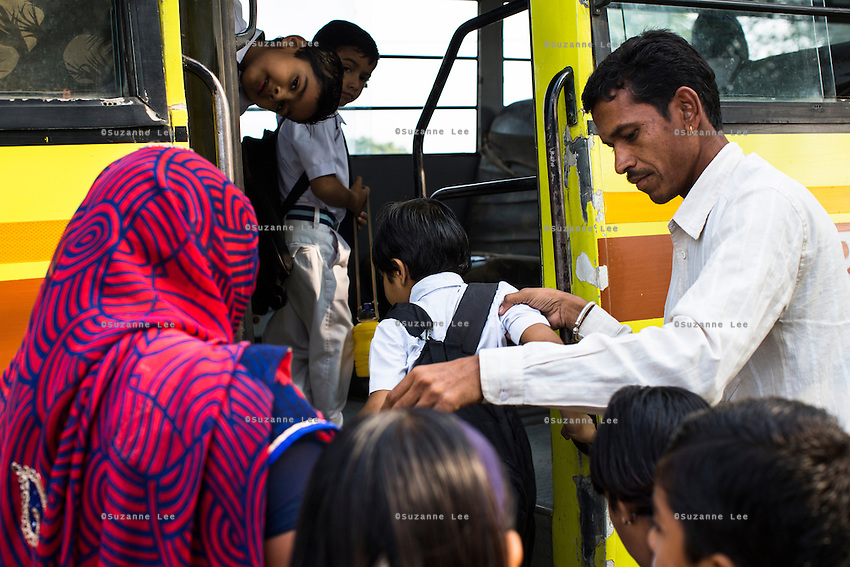 Sugna Jat, 30, puts her son Hemant Jat, 6, onto the school bus in Maheshwar, Khargone, Madhya Pradesh, India on 13 November 2014. Hemant, the son of Fairtrade cotton farmers, wants to be a police man when he grows up and gets a 5% discount of school fees at the Vasudha school. His parents would be happy if Hemant took over the farm but if he does well in school, he could look for other careers. Photo by Suzanne Lee for Fairtrade